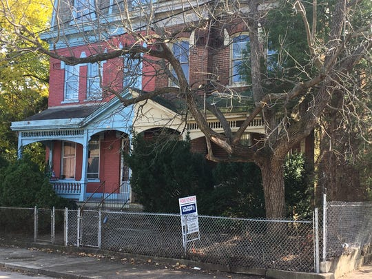 """This home at 119 Martin St. in Covington is listed for $35,000, and is """"probably not haunted,'' according to the for-sale sign"""