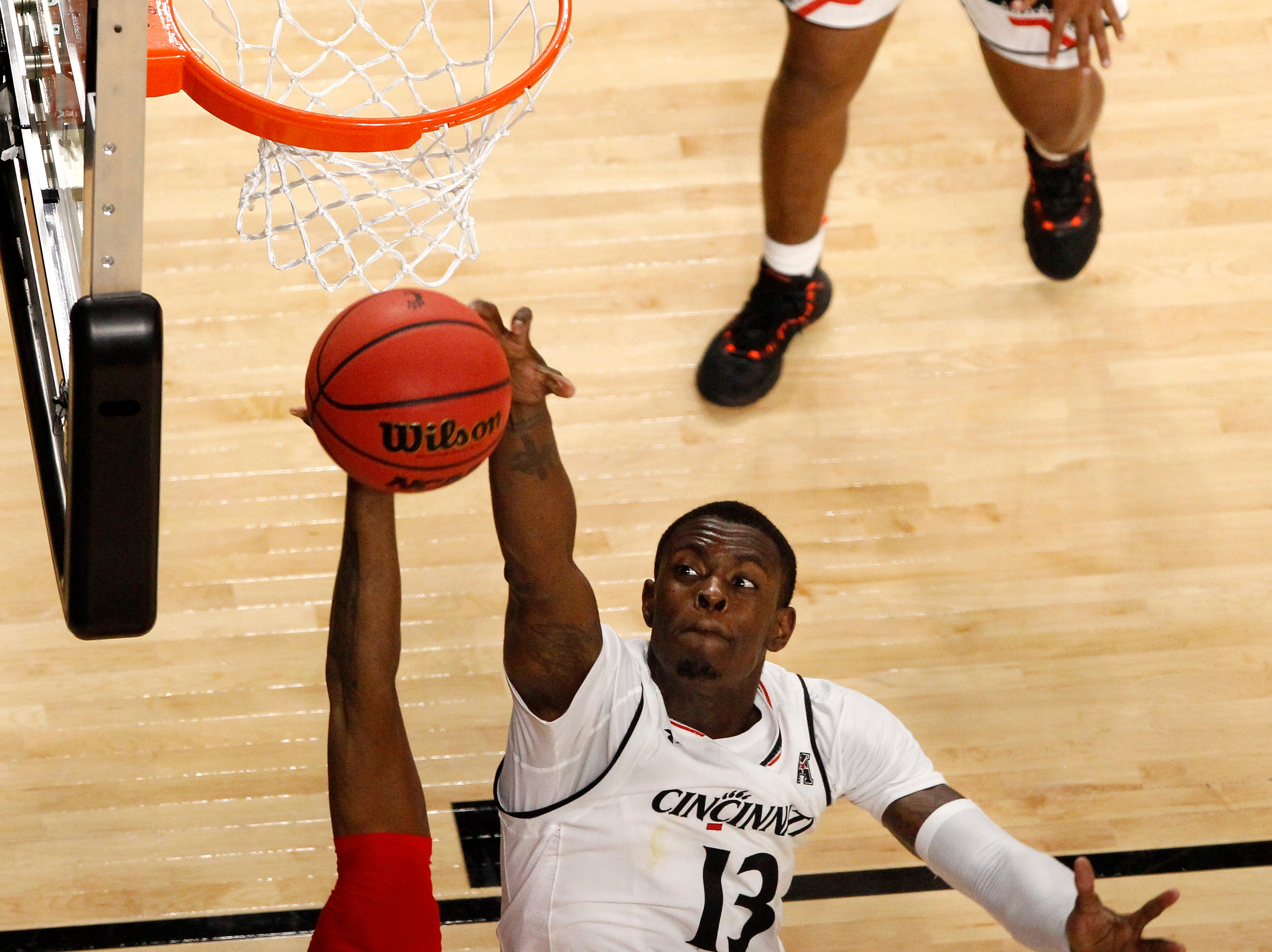 Cincinnati Bearcats forward Tre Scott (13) blocks a shot in the second half of a college basketball game between the Ohio State Buckeyes and the Cincinnati Bearcats, Wednesday, Nov. 7, 2018, at Fifth Third Arena in Cincinnati.