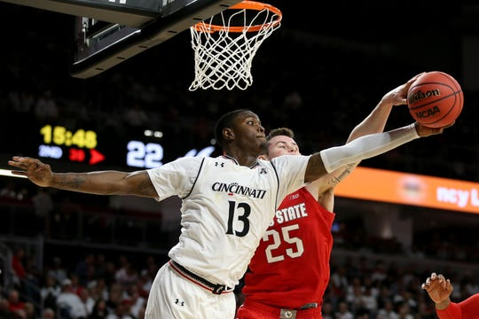 Cincinnati Bearcats forward Trevon Scott (13) reaches for rebound against Ohio State Buckeyes forward Kyle Young (25) in the second half of a college basketball game between the Ohio State Buckeyes and the Cincinnati Bearcats, Wednesday, Nov. 7, 2018, at Fifth Third Arena in Cincinnati.