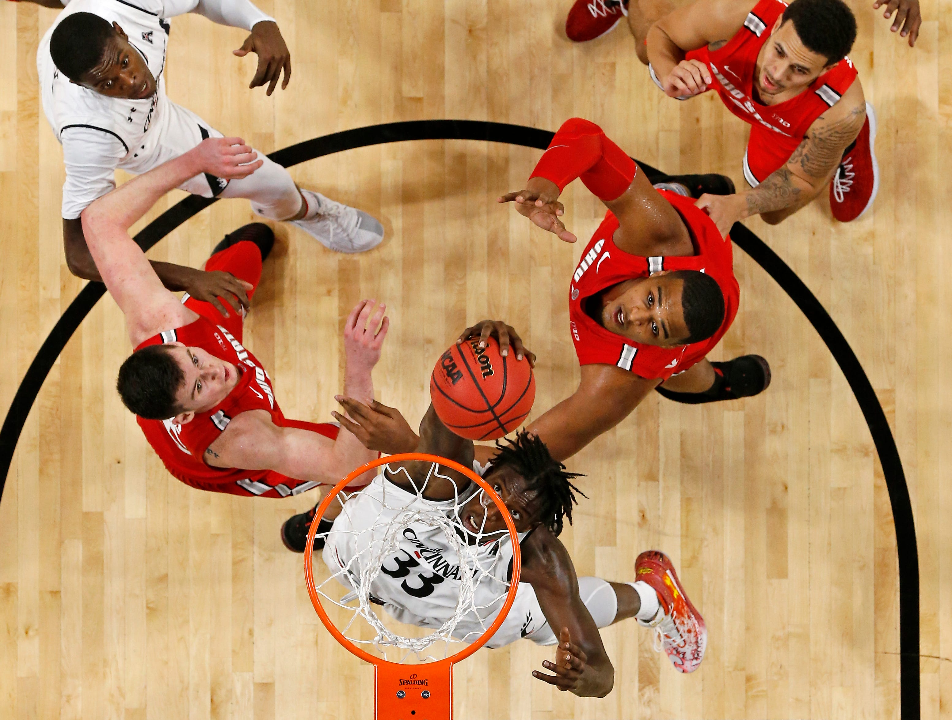 Cincinnati Bearcats center Nysier Brooks (33) puts up a shot in the second half of the NCAA basketball game between the Cincinnati Bearcats and the Ohio State Buckeyes at Fifth Third Arena in Cincinnati on Wednesday, Nov. 7, 2018. The Bearcats opened the season 0-1 with a 64-56 loss the Ohio State.