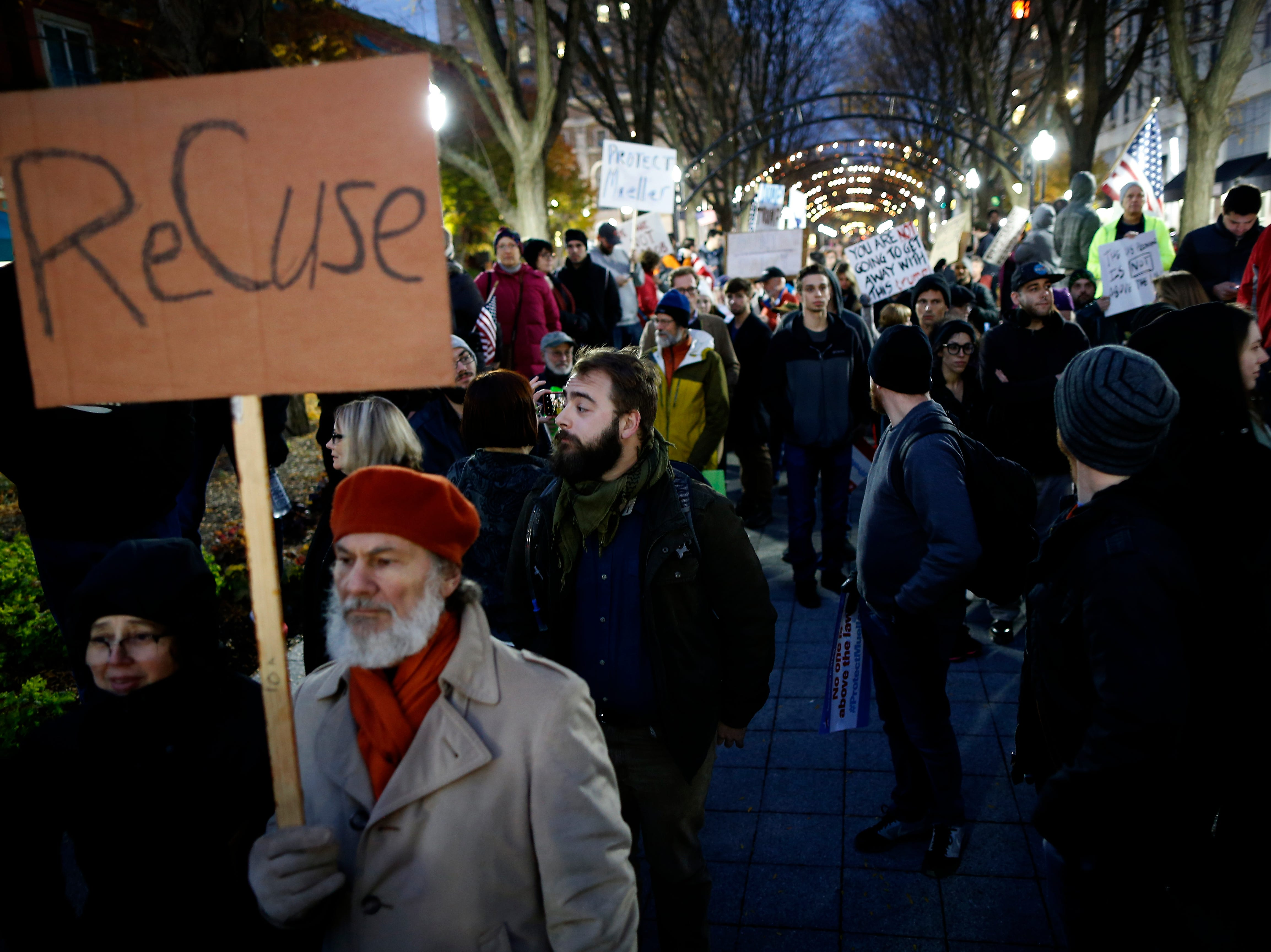 Demonstrators gather after completing a march around downtown during a nationwide protest following the resignation of attorney general Jeff Sessions and President Donald Trump's appointment of Matthew Whitaker at Piatt Park in downtown Cincinnati on Thursday, Nov. 8, 2018.