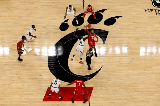 Cincinnati Bearcats center Nysier Brooks (33) and Ohio State Buckeyes forward Kaleb Wesson (34) leap for the opening tip in the first half of a college basketball game between the Ohio State Buckeyes and the Cincinnati Bearcats, Wednesday, Nov. 7, 2018, at Fifth Third Arena in Cincinnati.