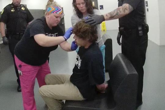 Jail medical staff dress inmate Steven Jordan's head wound.