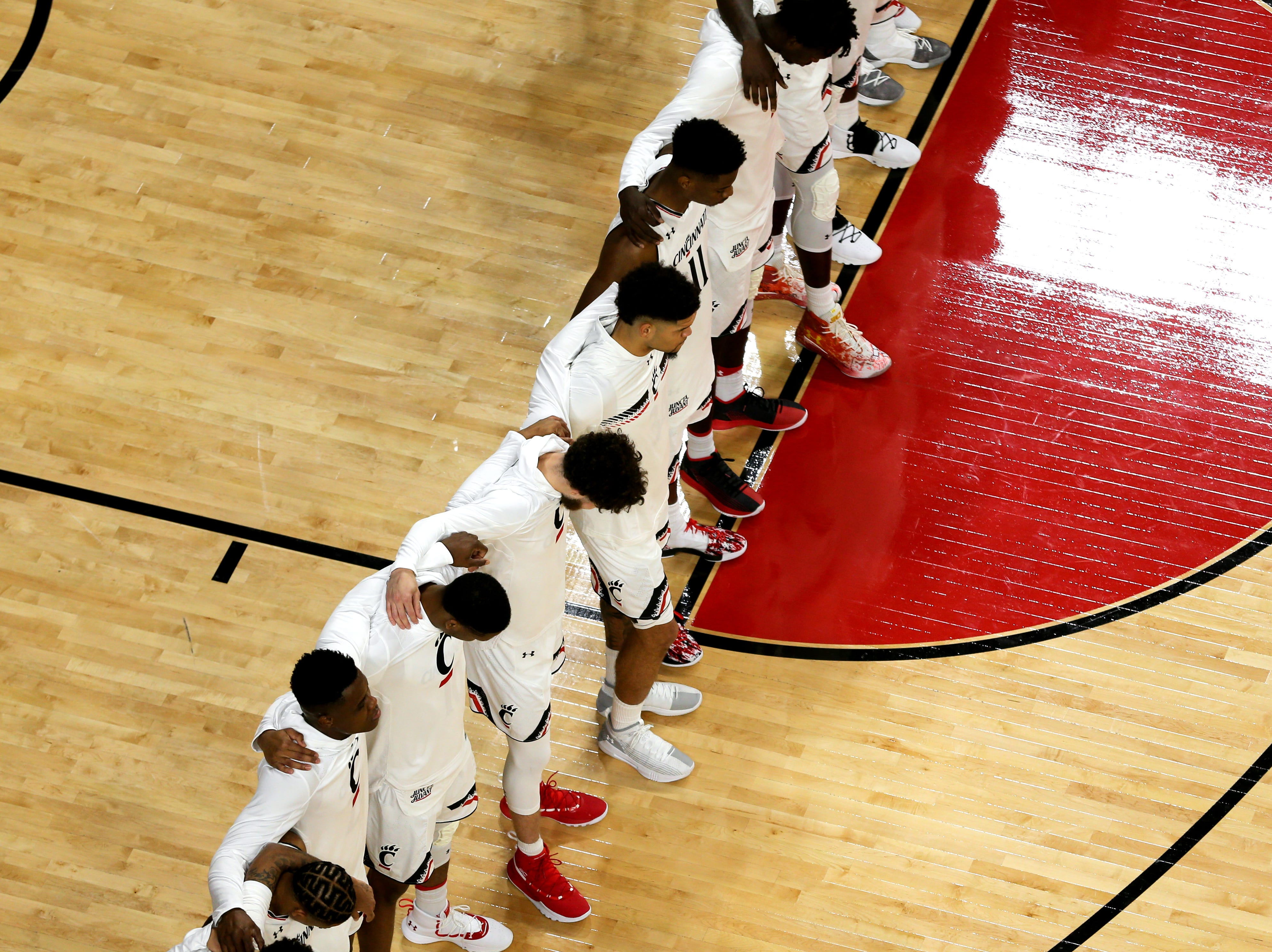 The Cincinnati Bearcats basketball team stands for the national anthem before a college basketball game between the Ohio State Buckeyes and the Cincinnati Bearcats, Wednesday, Nov. 7, 2018, at Fifth Third Arena in Cincinnati.
