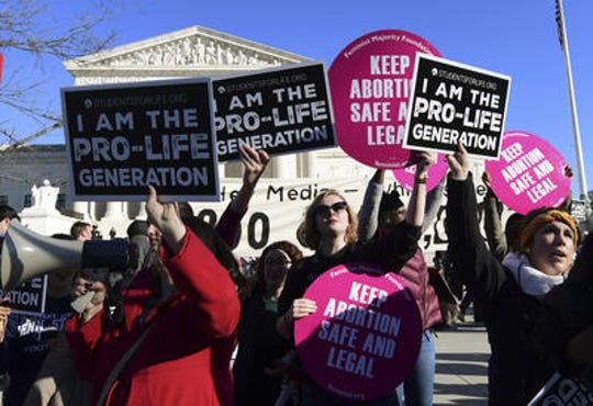 A crowd gathers outside the U.S. Supreme Court in January to defend and protest legalized abortion.