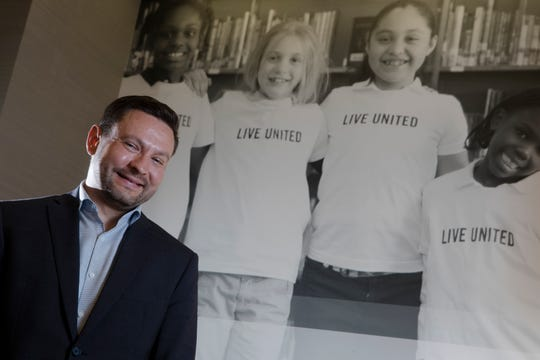 Ross Meyer, United Way of Cincinnati Interim CEO, stands inside the Cincinnati United Way office on Thursday, Nov. 8, 2018.