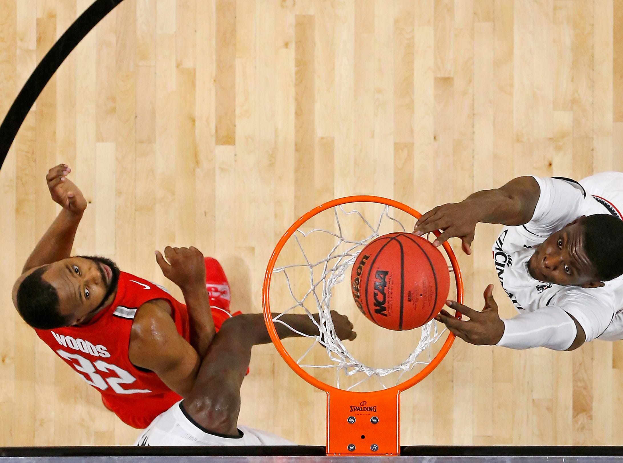 Cincinnati Bearcats forward Tre Scott (13) puts down a dunk in the second half of the NCAA basketball game between the Cincinnati Bearcats and the Ohio State Buckeyes at Fifth Third Arena in Cincinnati on Wednesday, Nov. 7, 2018. The Bearcats opened the season 0-1 with a 64-56 loss the Ohio State.