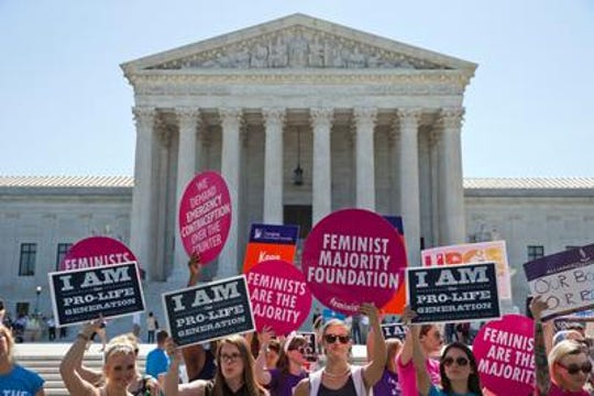 Protesters on both sides of the abortion debate outside the U.S. Supreme Court in 2017.