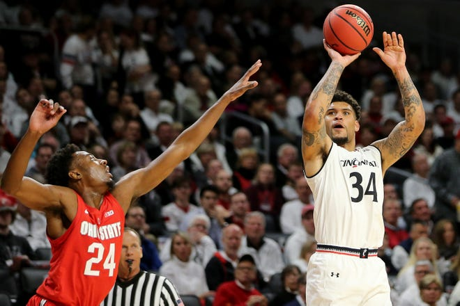 Cincinnati Bearcats guard Jarron Cumberland (34) rises for a shot over Ohio State Buckeyes forward Andre Wesson (24) in the second half of a college basketball game between the Ohio State Buckeyes and the Cincinnati Bearcats, Wednesday, Nov. 7, 2018, at Fifth Third Arena in Cincinnati.