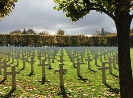 Argonne American Cemetery, the solemn final resting place of more than 14,000 brave Americans, where white crosses and stars of David mark their graves.
