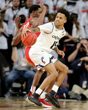 Cincinnati Bearcats guard Cane Broome (15) spins toward the basket in the first half of a college basketball game between the Ohio State Buckeyes and the Cincinnati Bearcats, Wednesday, Nov. 7, 2018, at Fifth Third Arena in Cincinnati.