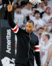 Kenyon Martin, the No. 1 pick in the 2000 NBA Draft, waves to fans during UC's game against Ohio State in November 2018.