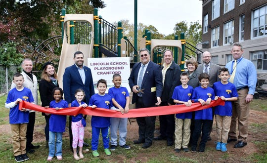 Freeholder Chairman Sergio Granados, and Freeholders Alexander Mirabella, Bruce Bergen and Bette Jane Kowalski (of Cranford) joined with children from Cranford's Lincoln School, Cranford Superintendent of Schools Dr. Scott Rubin, and Lincoln School Principal Dennis McCaffery (both right end)  to cut the ribbon on a new playground the Freeholder Board gave to the school. Also in attendance were Mike Brennan of the County's Parks Department and Nicole DeAugustine of the County's Office for People with Special Needs (left end).
