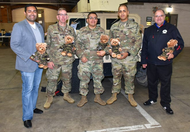 Union County Freeholder Chairman Sergio Granados and Freeholder Angel G. Estrada joined Union County Deputy Manager Amy Wagner, Union County Office of Veteran Services Coordinator Janna Williams and staff from the Veterans Services Office in distributing Build-A-Bear stuffed bears with recordable devices to members of the Army National Guard at the Westfield Armory  who will deploy overseas in December. Soldiers can record a message in their own voice for their loved ones while they are deployed. The Union County Office of Veteran Services provided 120 bears to soldiers deploying overseas. The program is part of Chairman Granados's UC Hero III initiative.
