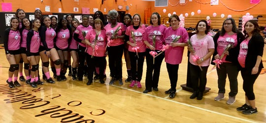 The Linden High School girls volleyball team presented breast cancer survivors with pink roses at their Pink Out match, which raised $1,400 to fight breast cancer, on Oct. 24.