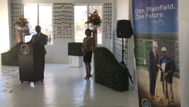 Plainfield Mayor Adrian O. Mapp announces the city's half billion-dollar downtown redevelopment plan on Nov. 8 at the Arts Loft during a business luncheon with potential investors and commercial real estate developers. Pictured to his left is his administration's Chief of Staff Jazz Clayton-Hunt.