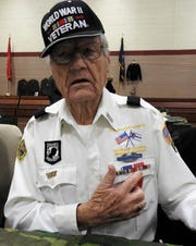"""Irwin R. """"Gibby"""" Gibson explains what the different ribbons and medals on his chest represent."""