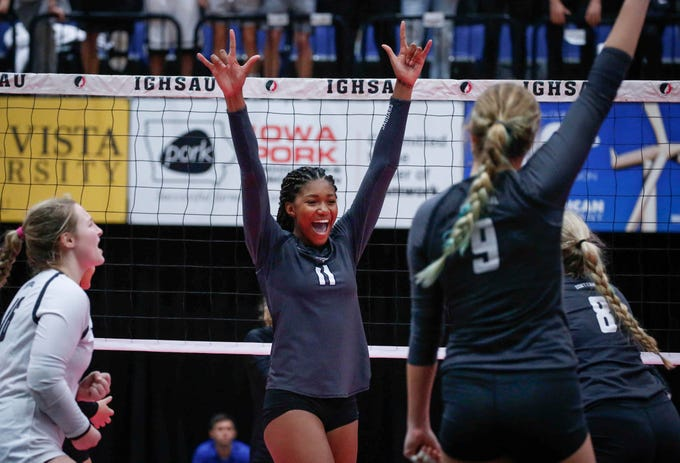 Ankeny Centennial's Devyn Robinson (No. 11) reacts after scoring a point against Valley in Class 5A during the 2018 Iowa High School state volleyball tournament on Thursday, Nov. 8, 2018, in Cedar Rapids.