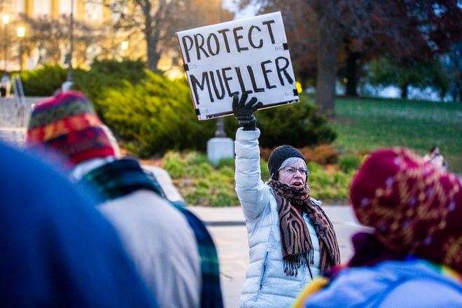 Paula Egan, of Des Moines, leads a chant during a rally at the Iowa State Capitol Grounds urging President Donald Trump to not to end the Mueller investigation, on Thursday, Nov. 8, 2018, in Des Moines.