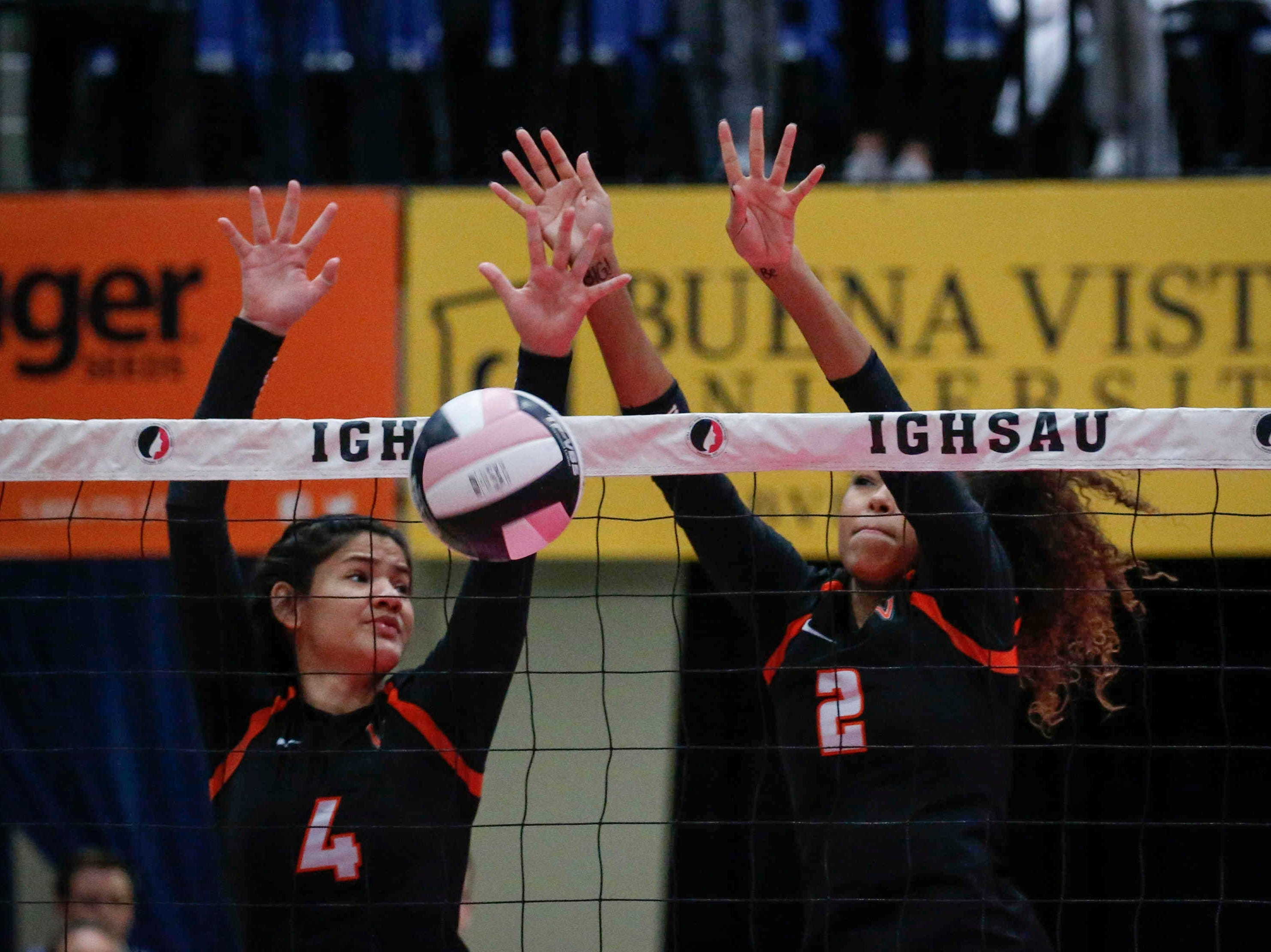 Valley's Jacey Spann, right, and Olivia Curry combine to stop a shot at the net against Ankeny Centennial in Class 5A during the 2018 Iowa High School state volleyball tournament on Thursday, Nov. 8, 2018, in Cedar Rapids.