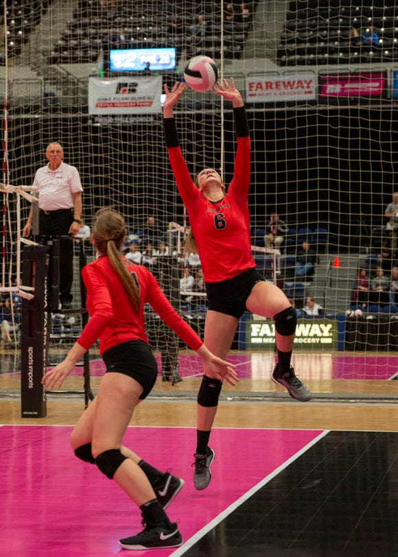 Linn-Mar's Megan Renner sets the ball during a match at the Iowa state volleyball tourament.