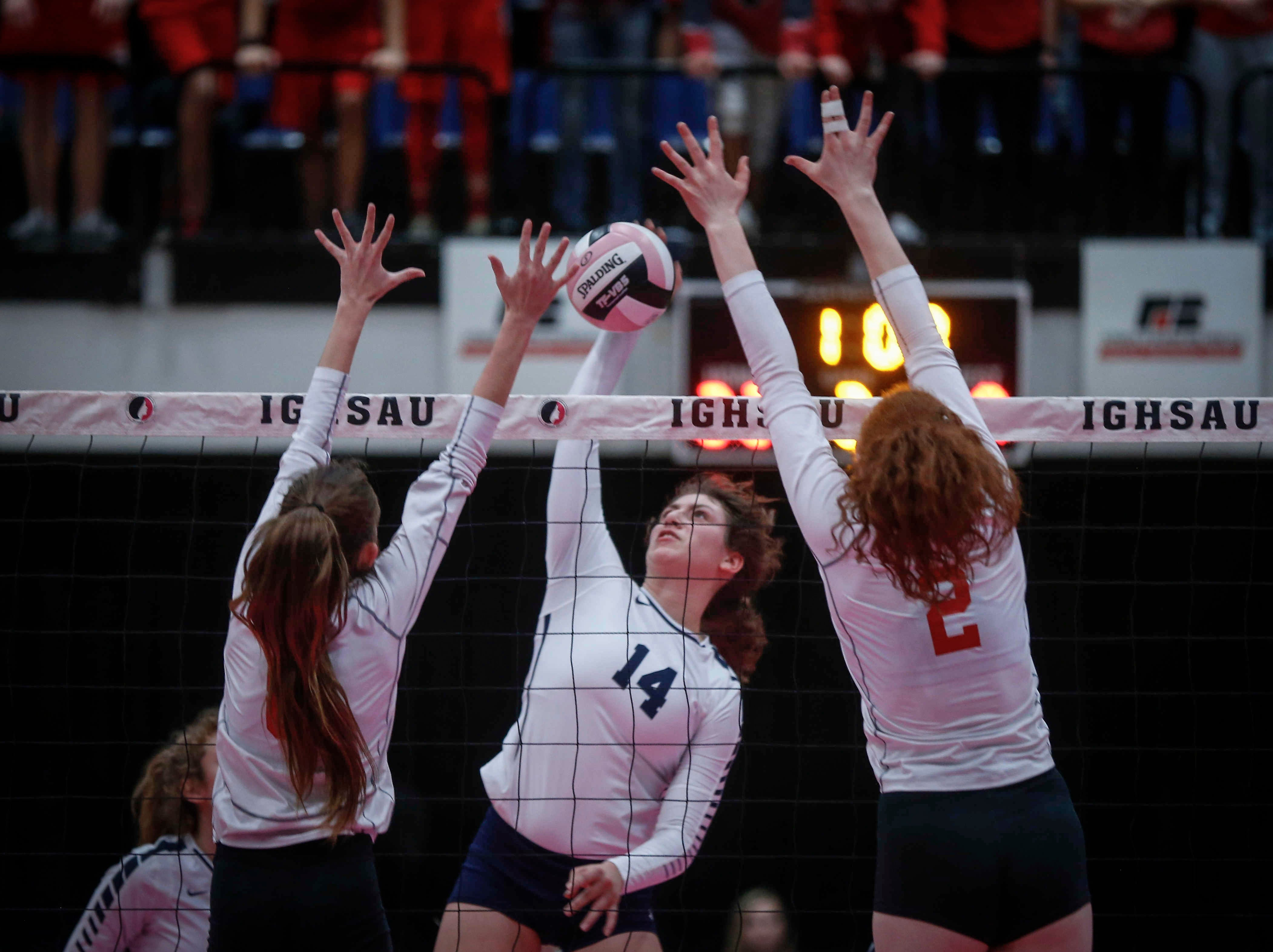 Cedar Rapids Xavier's Olivia Richards knocks the ball over the net against Dallas Center-Grimes in Class 4A during the 2018 Iowa High School state volleyball tournament on Thursday, Nov. 8, 2018, in Cedar Rapids.
