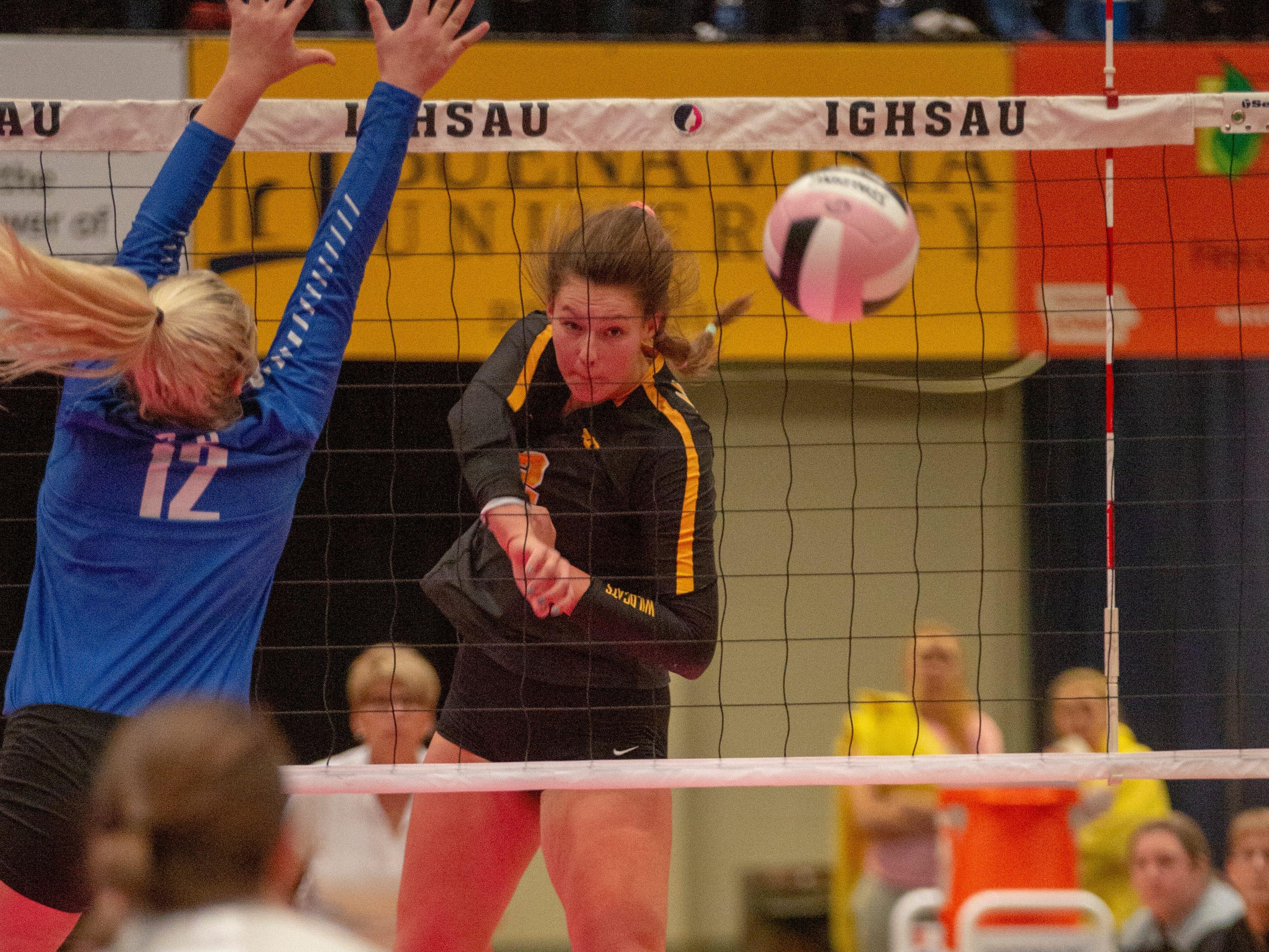 Janesville's Bree Thompson sends an attack during a quarterfinal match Wednesday.