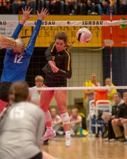 Janesville's Bree Thompson sends an attack during a quarterfinal match Wednesday.
