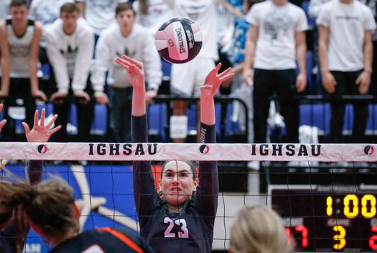 Ankeny Centennial's Megan Lively knocks the ball back over the net against Valley during the 2018 Iowa High School state volleyball tournament on Thursday, Nov. 8, 2018, in Cedar Rapids.