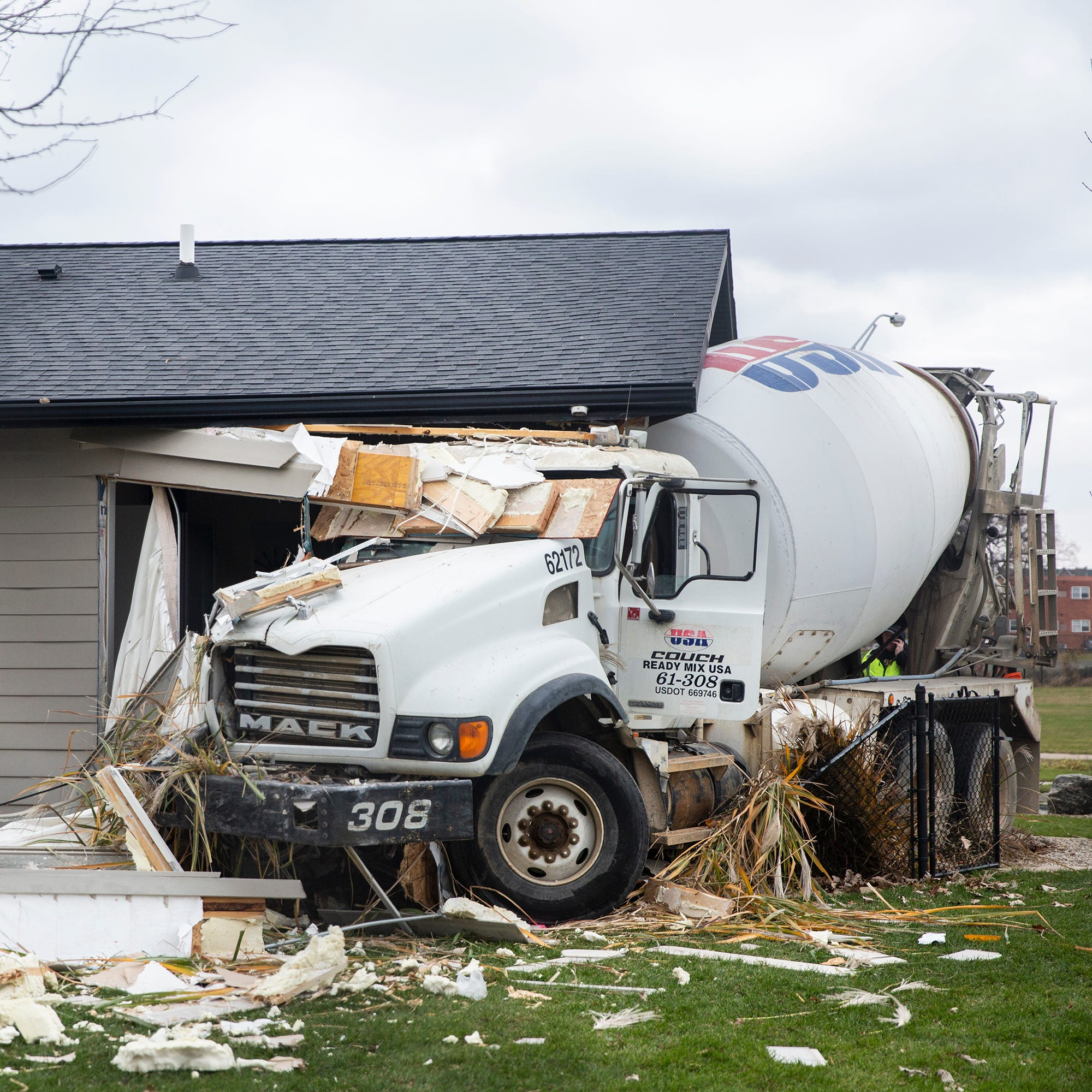 Cement truck driver who allegedly plowed into van, struck home identified