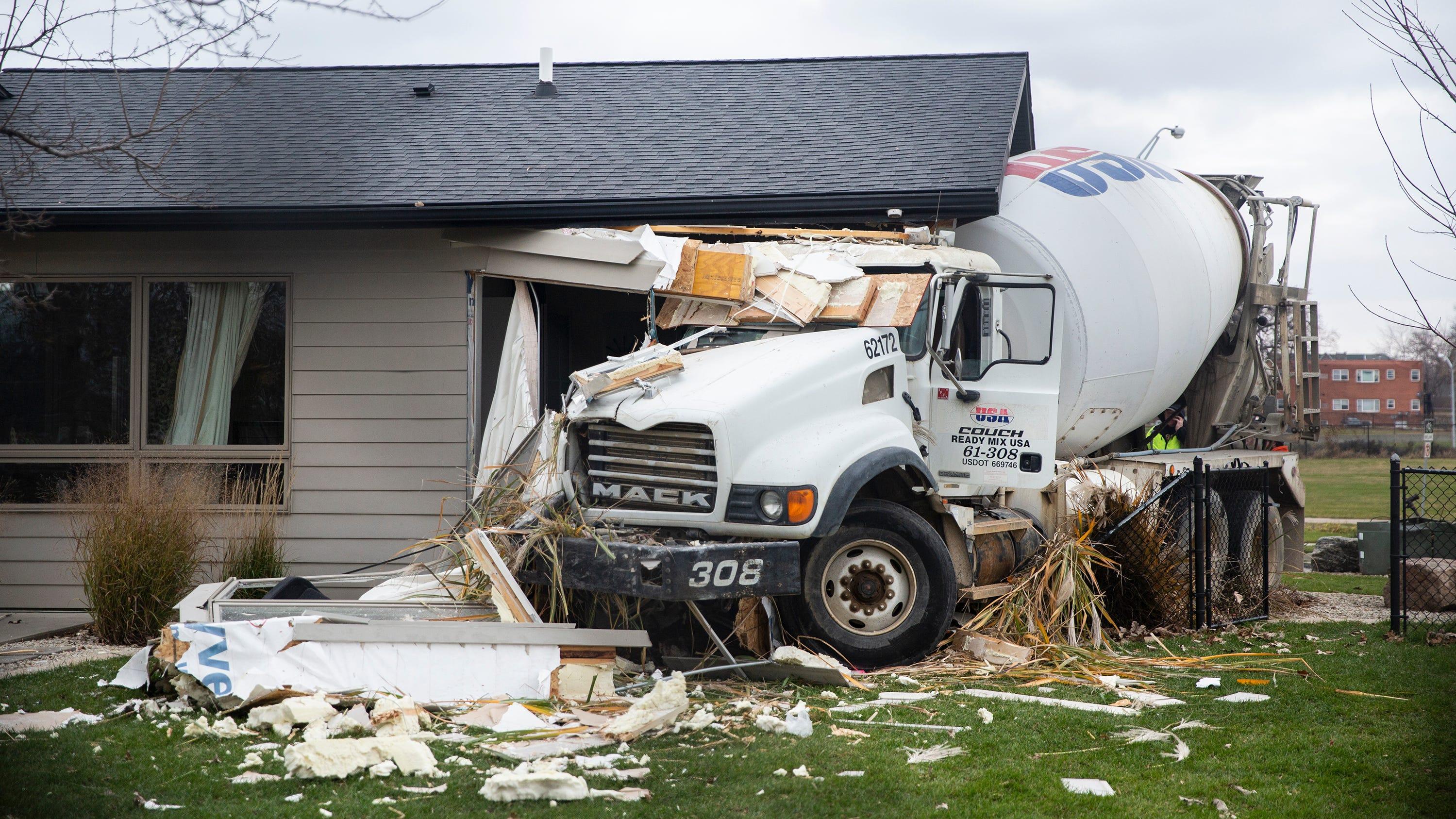 Photos: Cement truck crashes into a Des Moines home