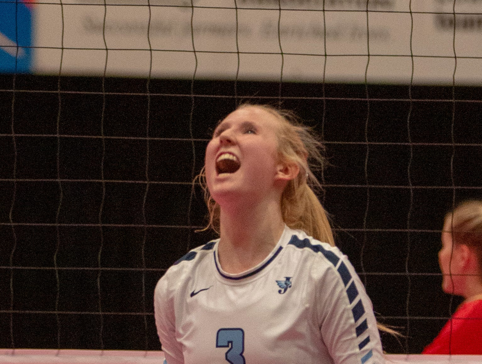Maddie Baxter celebrates a point for Cedar Rapids Jefferson in a state tournament match against Linn-Mar