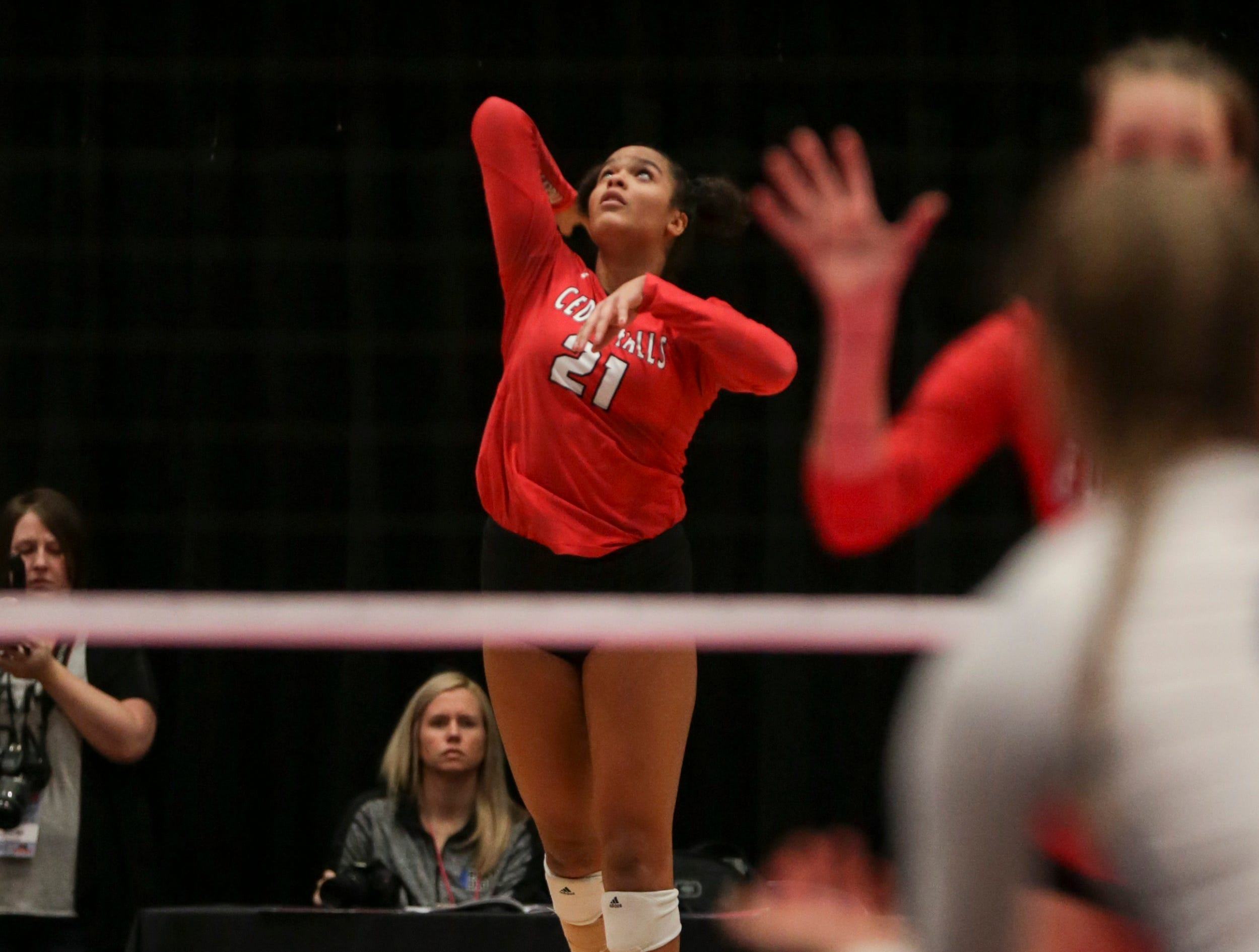 Akacia Brown of Cedar Falls skies for a serve during a state volleyball tournament match.