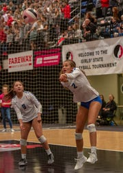 Dubuque Wahlert's Aliyah Carter digs out a serve during quarterfinal action at the Iowa state volleyball tournament.