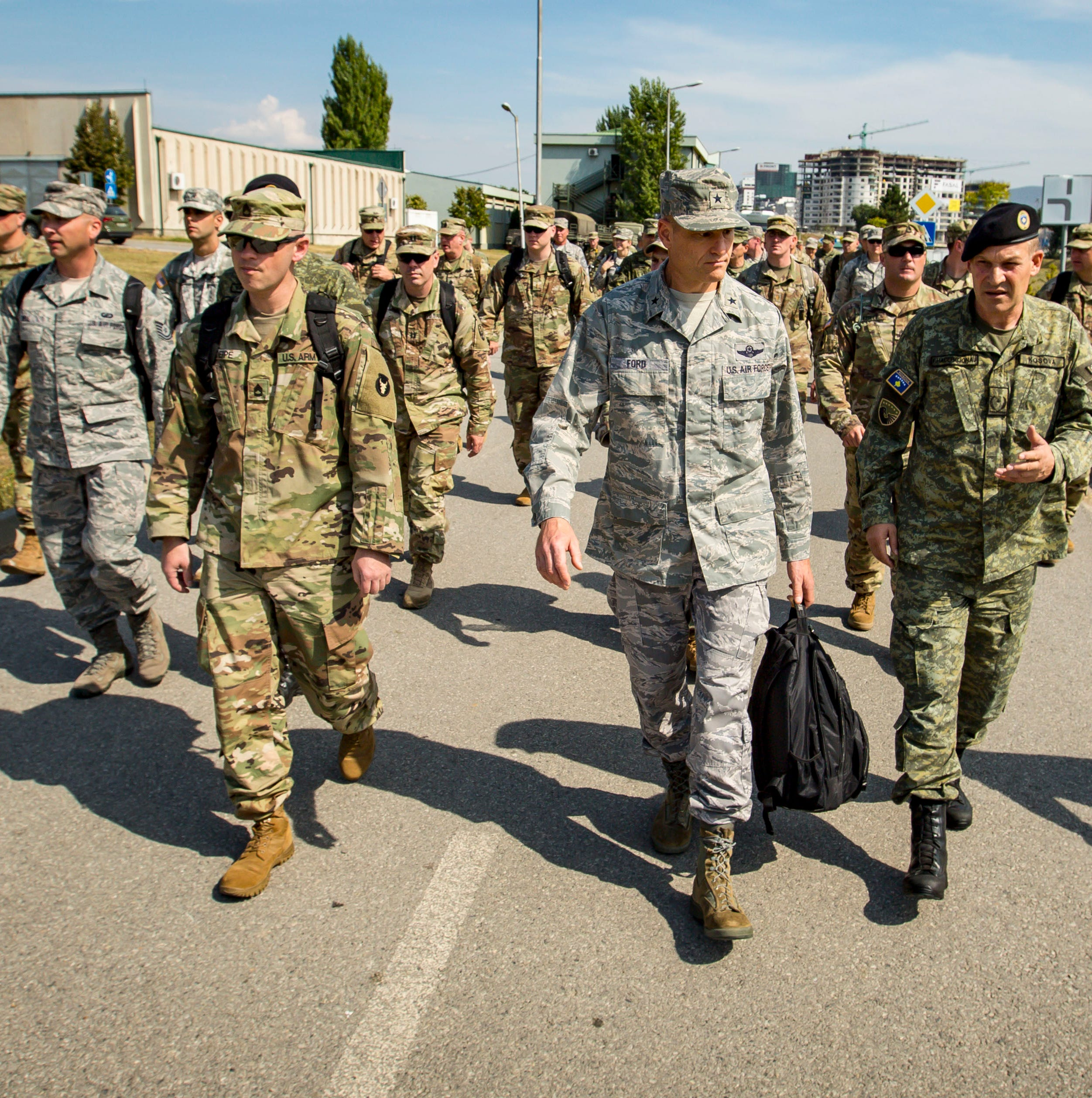 Brig. Gen. Shawn Ford, Deputy Adjutant General, Iowa Air National Guard, walks with members of the Kosovo Security Force at their base in Pristina, Kosovo, Sept. 18, 2018, during a staff ride in the country.