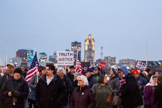 Around 100 people gathered at the Iowa State Capitol Grounds for a rally urging President Donald Trump to not to end the Mueller investigation, on Thursday, Nov. 8, 2018, in Des Moines.