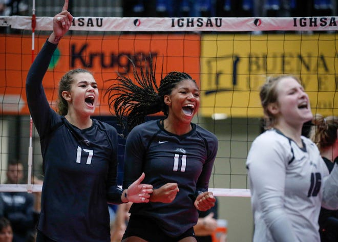Members of the Ankeny Centennial volleyball team celebrate after scoring a point against Valley in Class 5A during the 2018 Iowa High School state volleyball tournament on Thursday, Nov. 8, 2018, in Cedar Rapids.