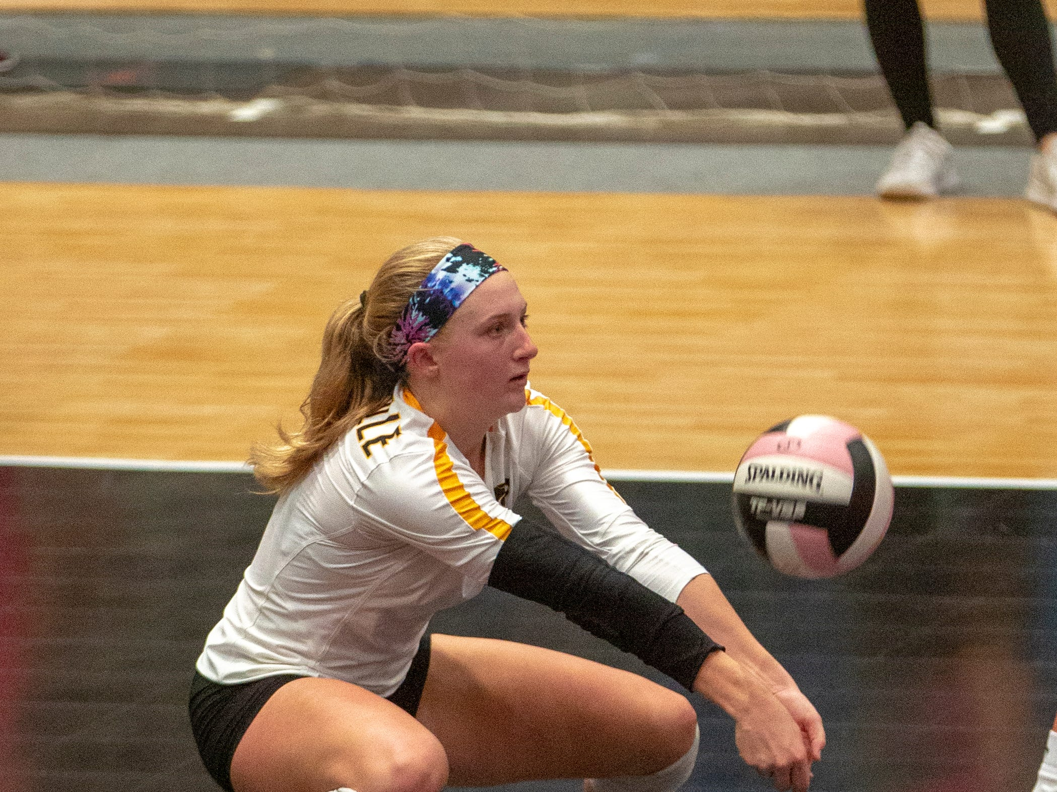 Lilly Liekweg of Janesville gets low for a dig Wednesday during a quarterfinal match.