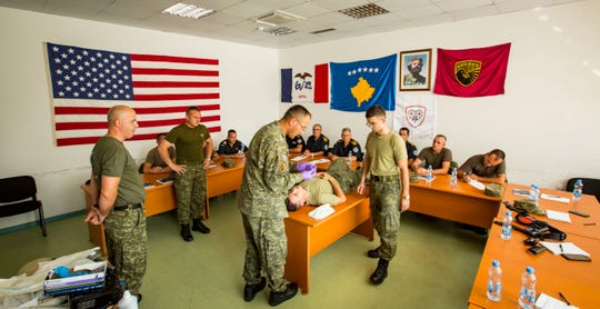 Kosovo Security Force members receive medical training as seen during a tour of their base by Iowa National Guard members in Pristina, Kosovo, Sept. 18, 2018.
