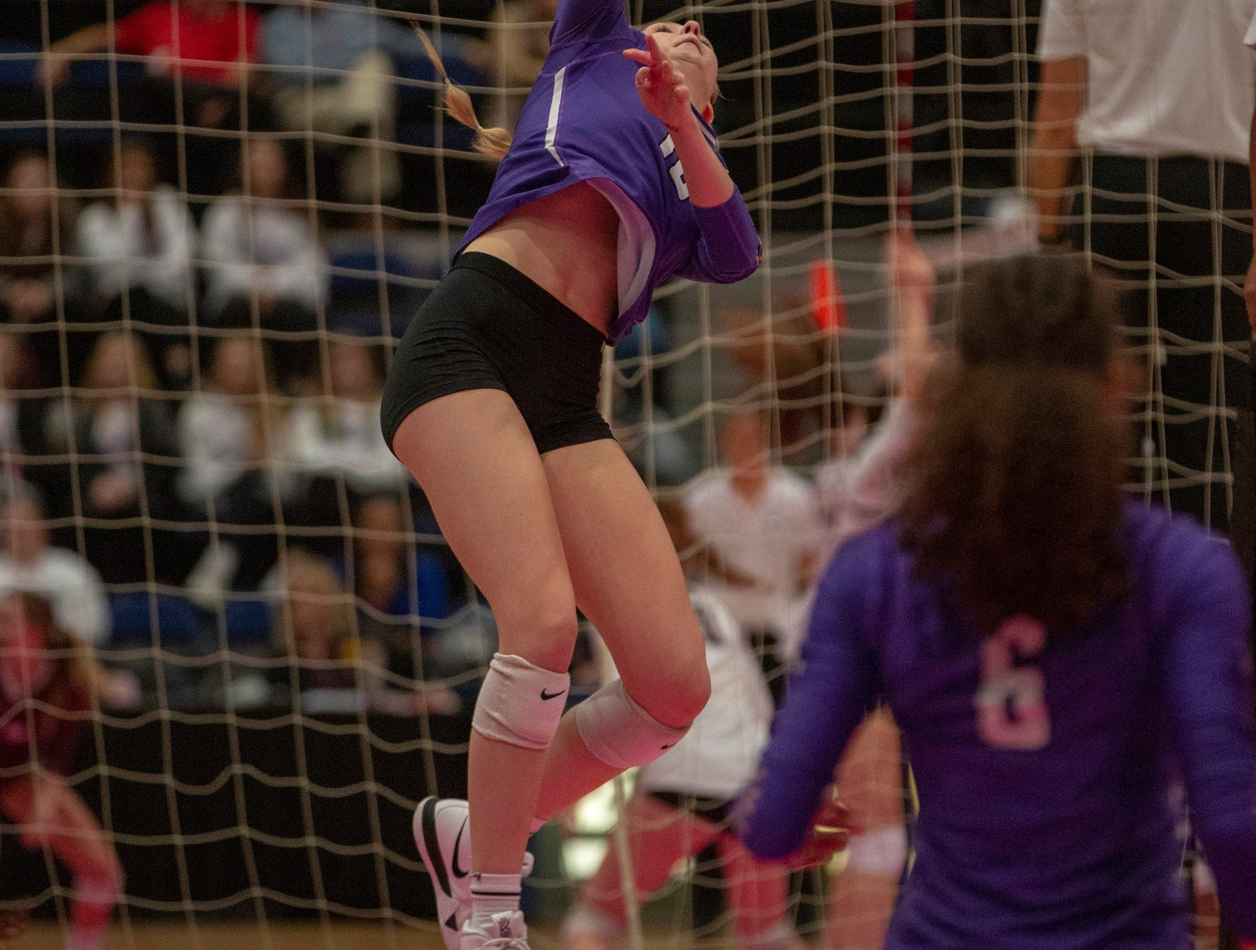 Waukee's Haley Bush goes up for an attack.
