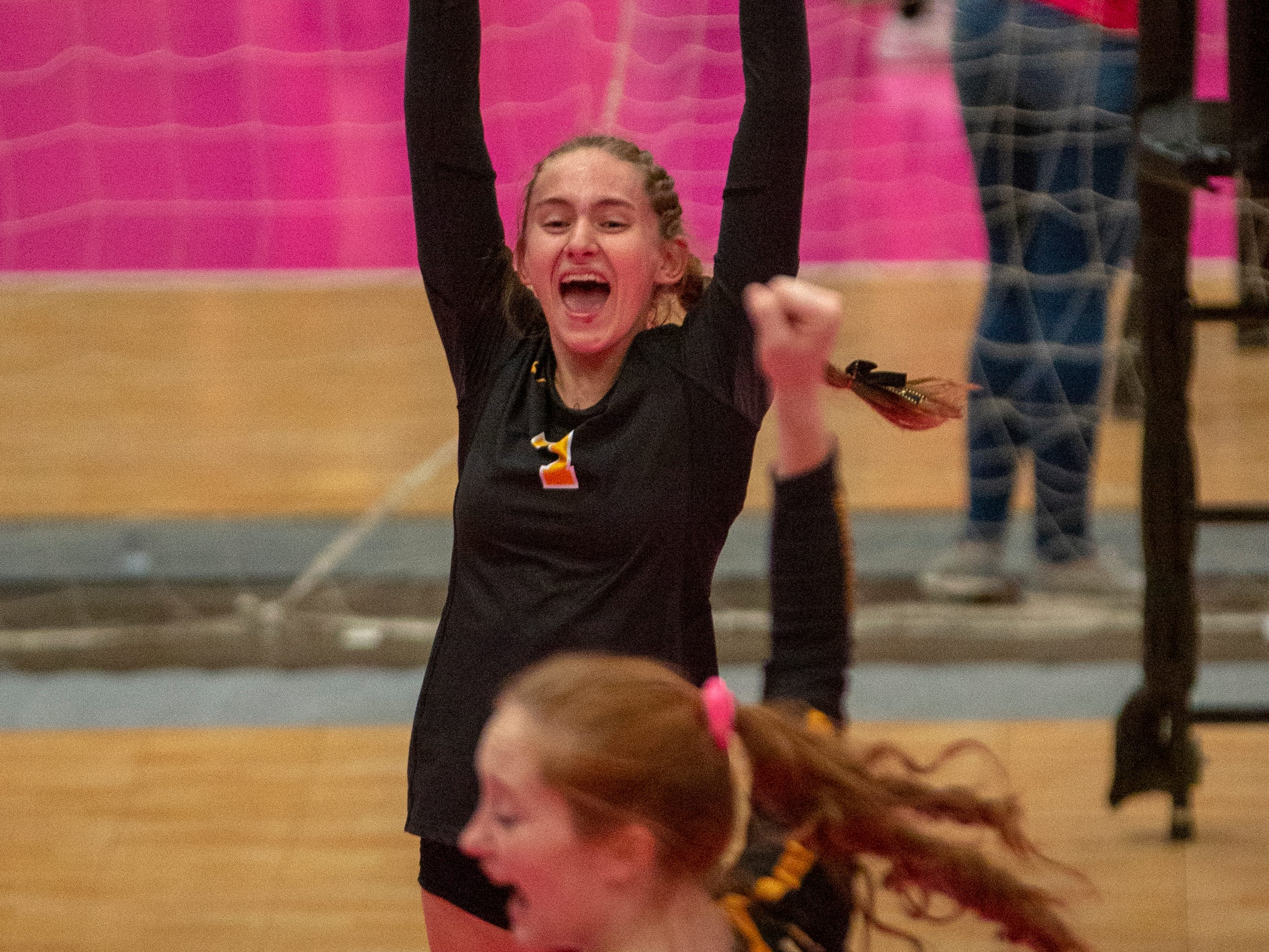 Alisa Bengen celebrates a point for Janesville during quarterfinal action Wednesday at the girls state volleyball tournament.