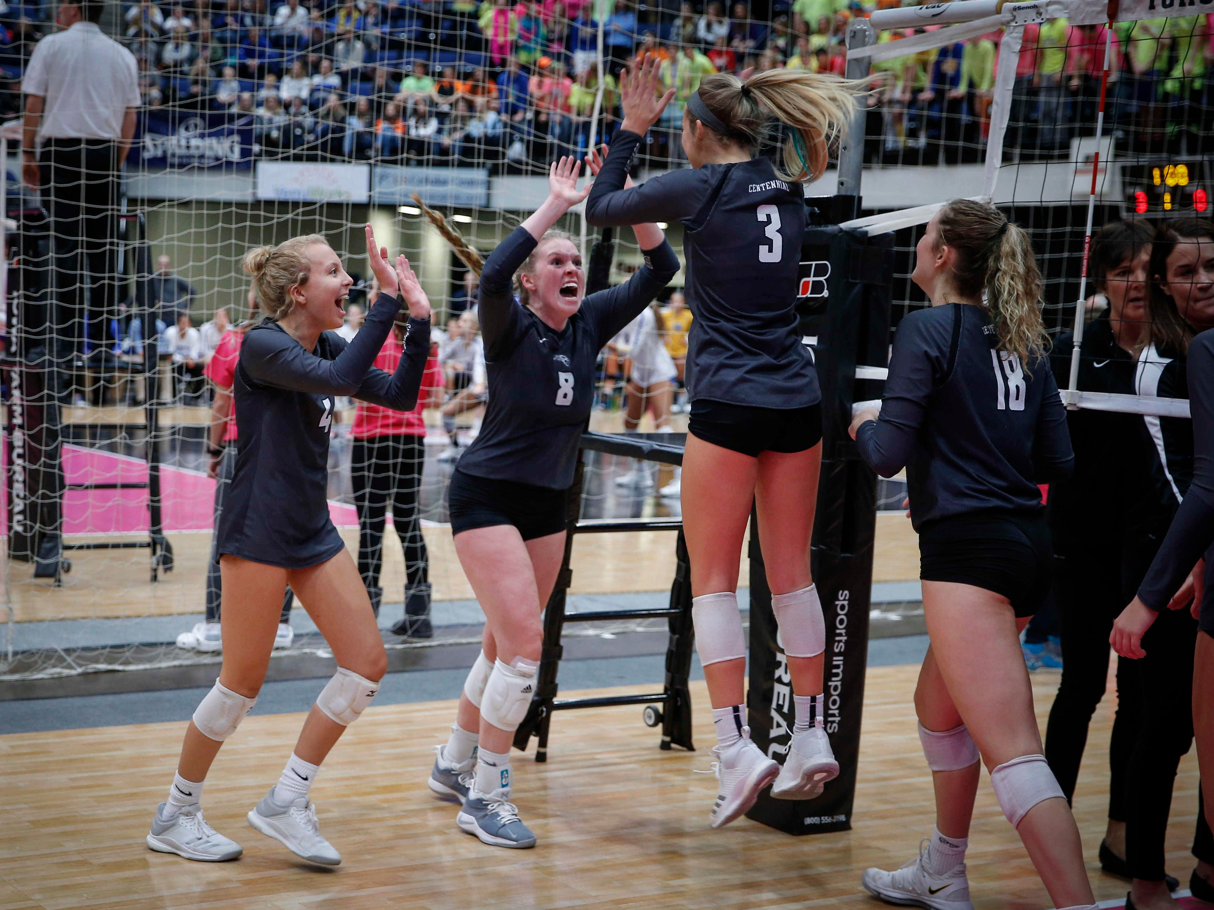 Members of the Ankeny Centennial volleyball team celebrate a 5-set win over West Des Moines Valley in Class 5A during the 2018 Iowa High School state volleyball tournament on Thursday, Nov. 8, 2018, in Cedar Rapids.