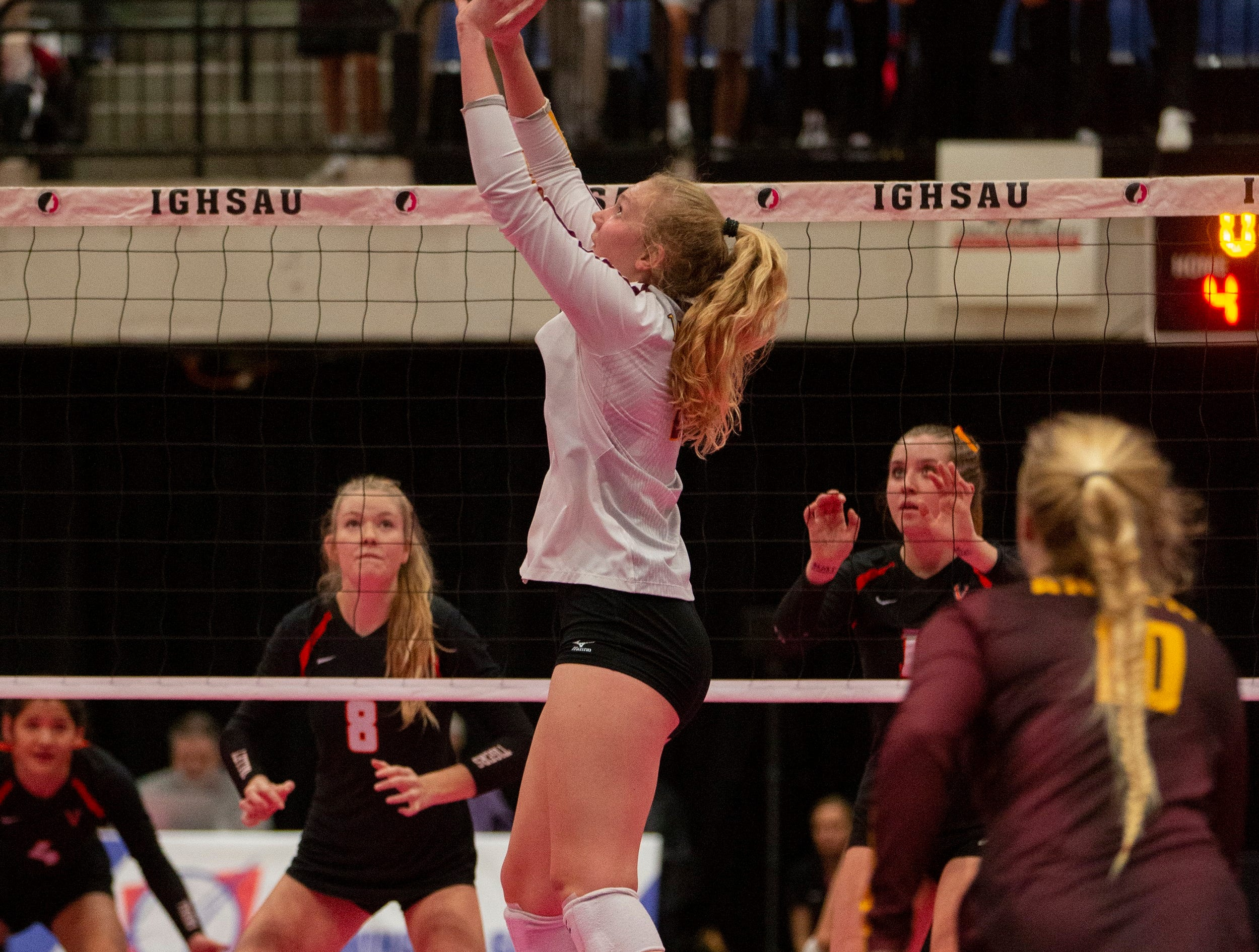 Ankeny's Phyona Schrader sets the ball during a quarterfinal match of the Iowa girls state volleyball tournament in Cedar Rapids.