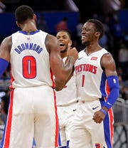 Detroit Pistons' Andre Drummond (0), Glenn Robinson III, center, and Reggie Jackson (1) celebrate a big play against the Orlando Magic during the second half Wednesday, Nov. 7, 2018, in Orlando.