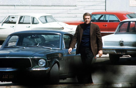 "Steve McQueen, starring in the title role of ""Bullitt,"" steps out of his car after a  pursuit through the hilly streets of San Francisco. The Technicolor action drama was filmed entirely on location in the Bay City."