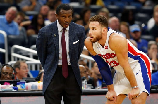 Detroit Pistons head coach Dwane Casey talks with forward Blake Griffin (23) against the Orlando Magic during the first quarter at Amway Center on Wednesday, Nov. 7, 2018.