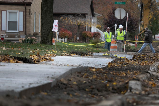 New sidewalks being installed in Dearborn are matching the contour of the wavy ground. Firestone Street is currently under construction and photographed Thursday, Nov. 8, 2018.