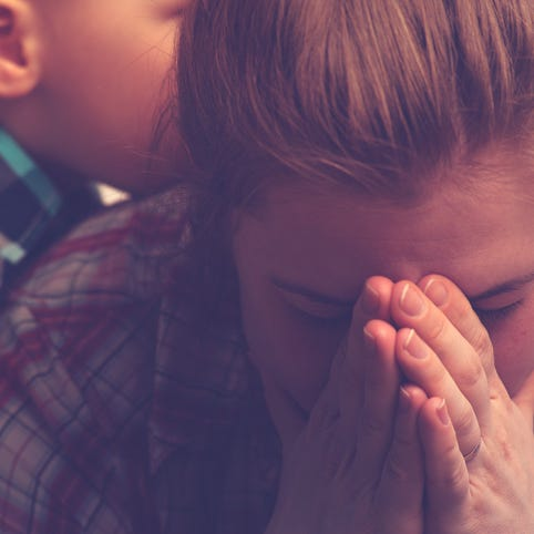 Young son senses his mother's grief