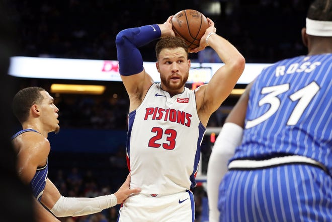 Detroit Pistons forward Blake Griffin (23) passes the ball as Orlando Magic forward Aaron Gordon (00) and Magic guard Terrence Ross (31) defend during the first quarter at Amway Center on Wednesday, Nov. 7, 2018.
