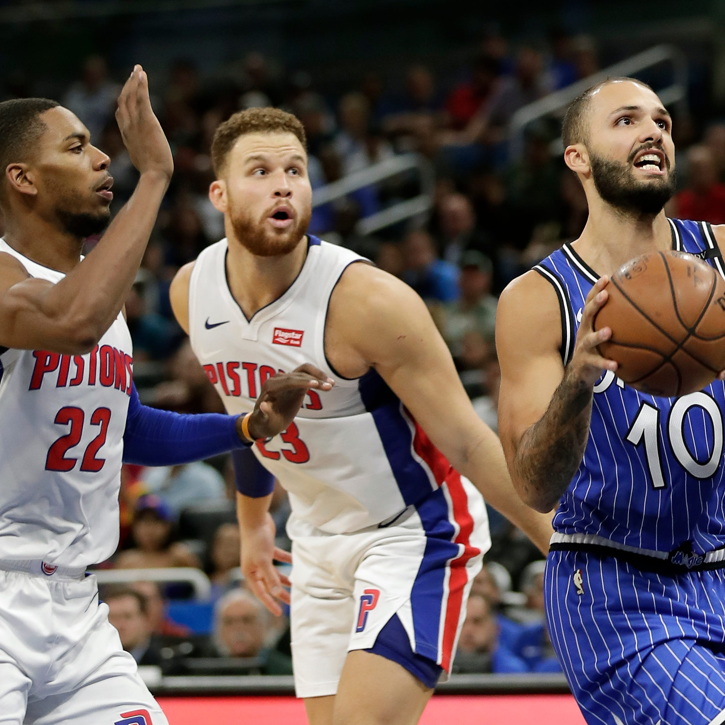 Orlando Magic's Evan Fournier looks for a shot as he gets past Detroit Pistons' Glenn Robinson III (22) and Blake Griffin (23) during the first half Nov. 7, 2018, in Orlando, Fla.